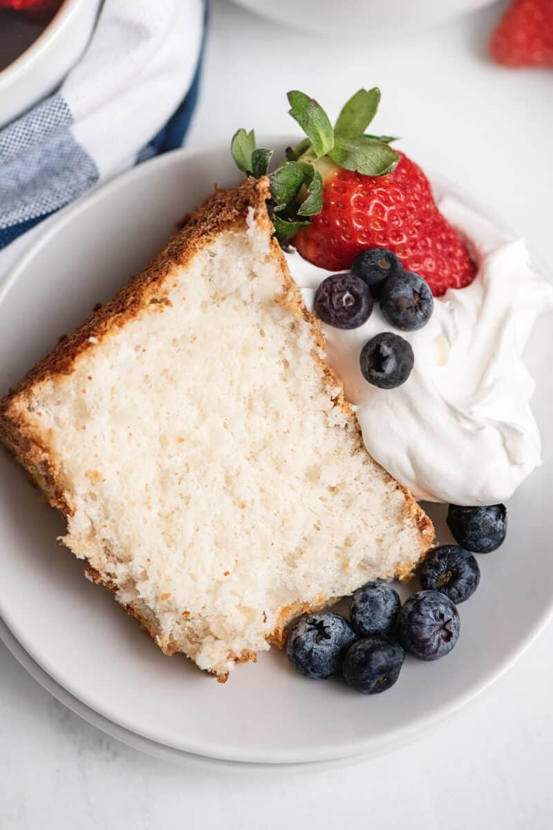 angel food cake topped with berries and cream