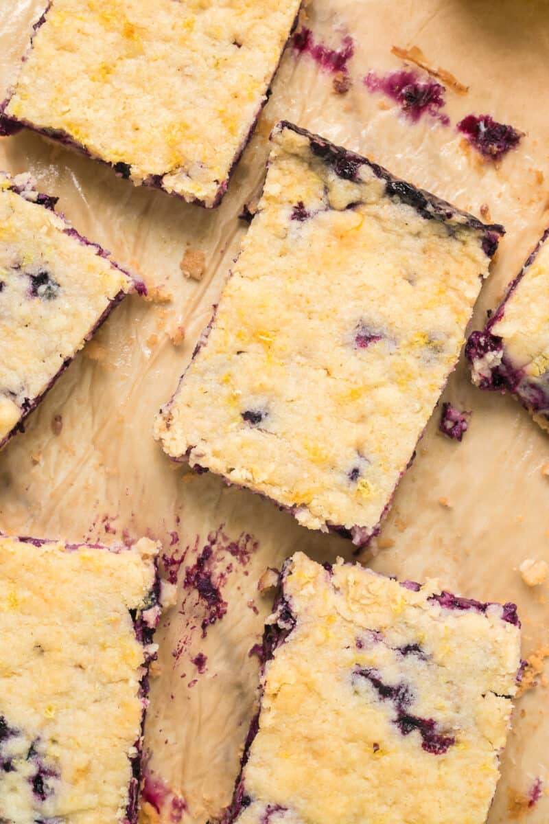 sliced blueberry pie bars on parchment