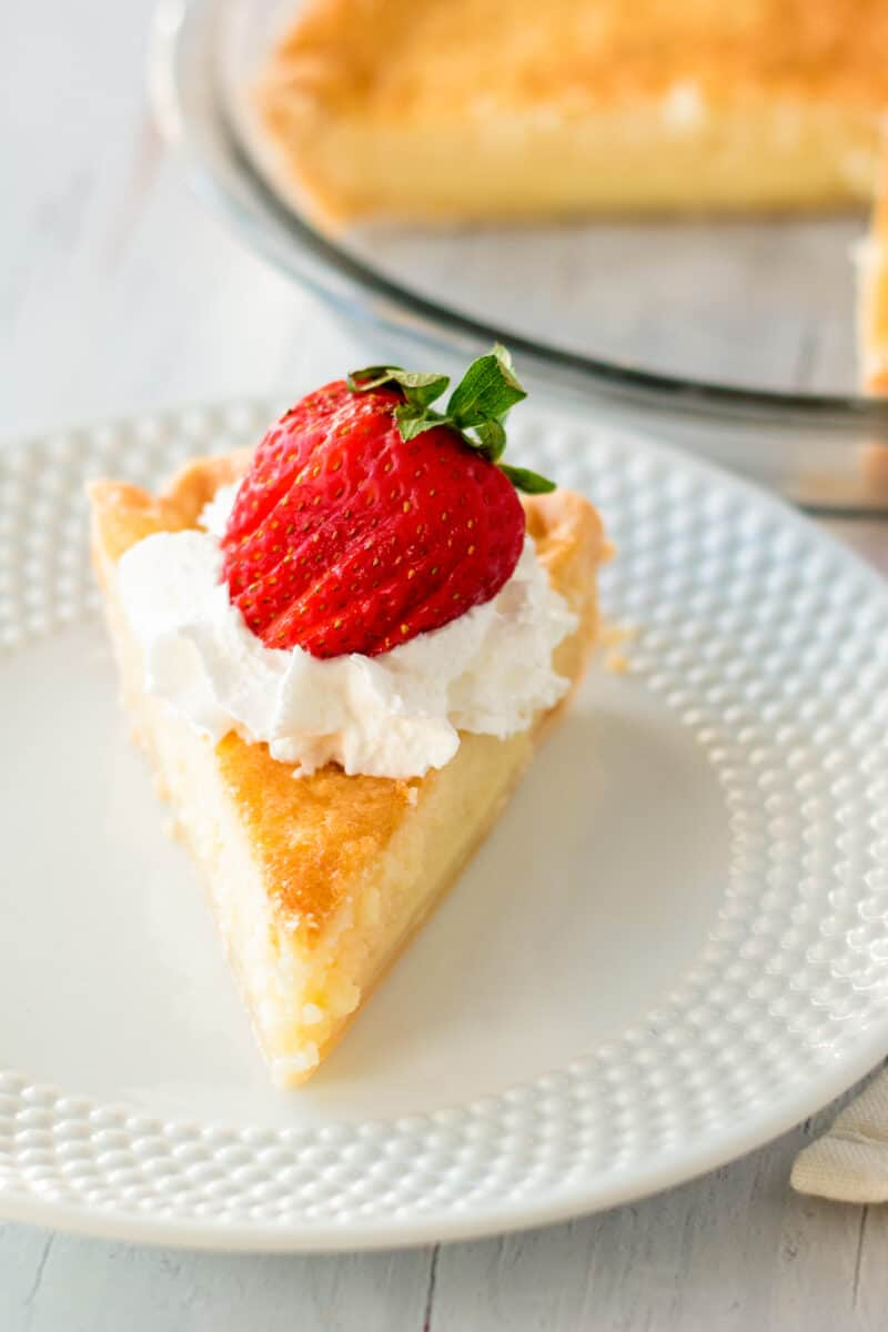 slice of buttermilk pie with strawberries and cream