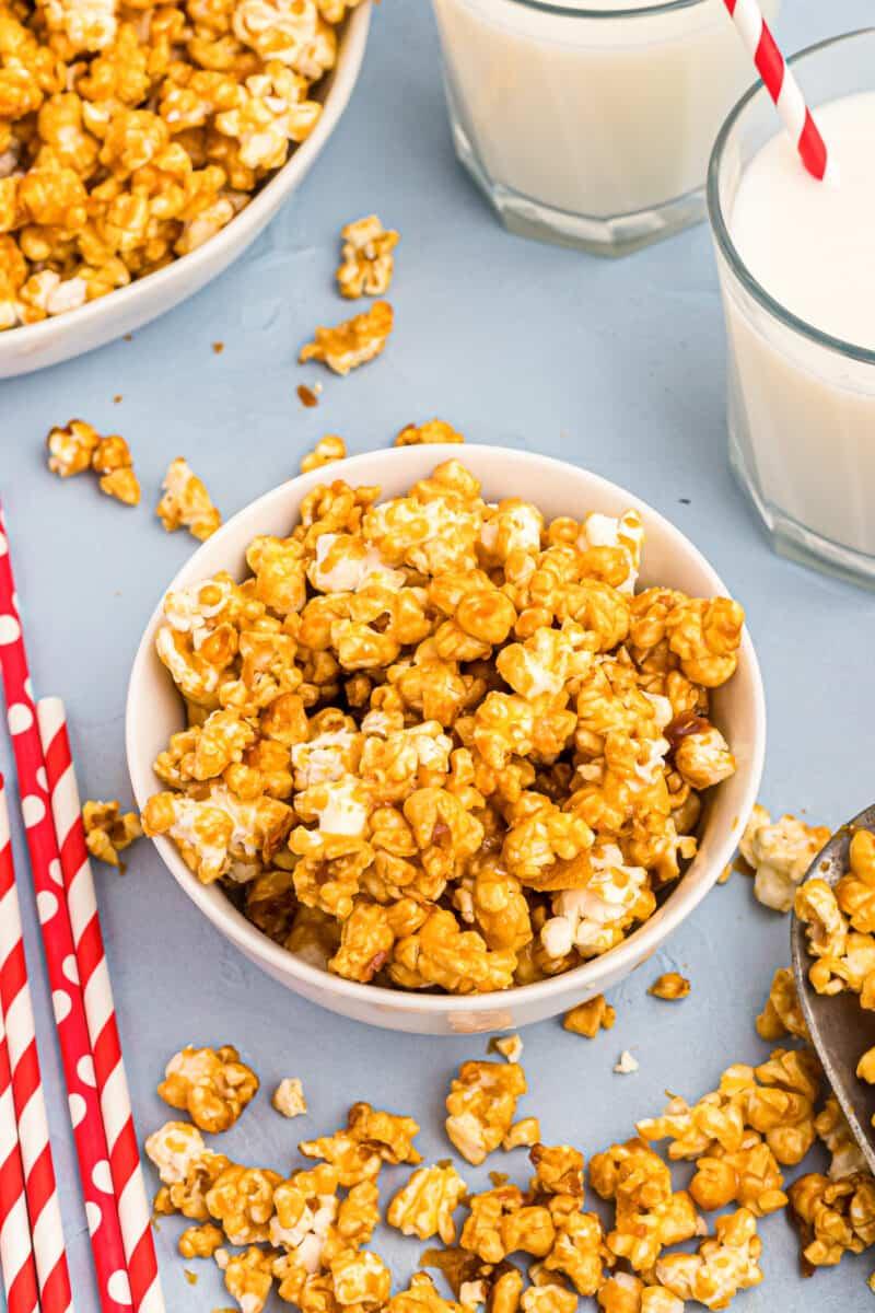 caramel corn in small white bowl