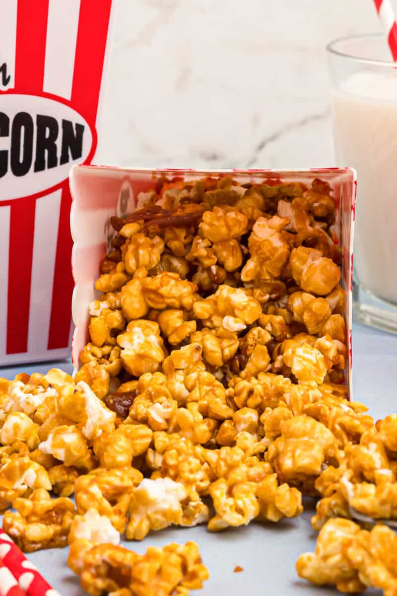 caramel corn spilling out of movie box