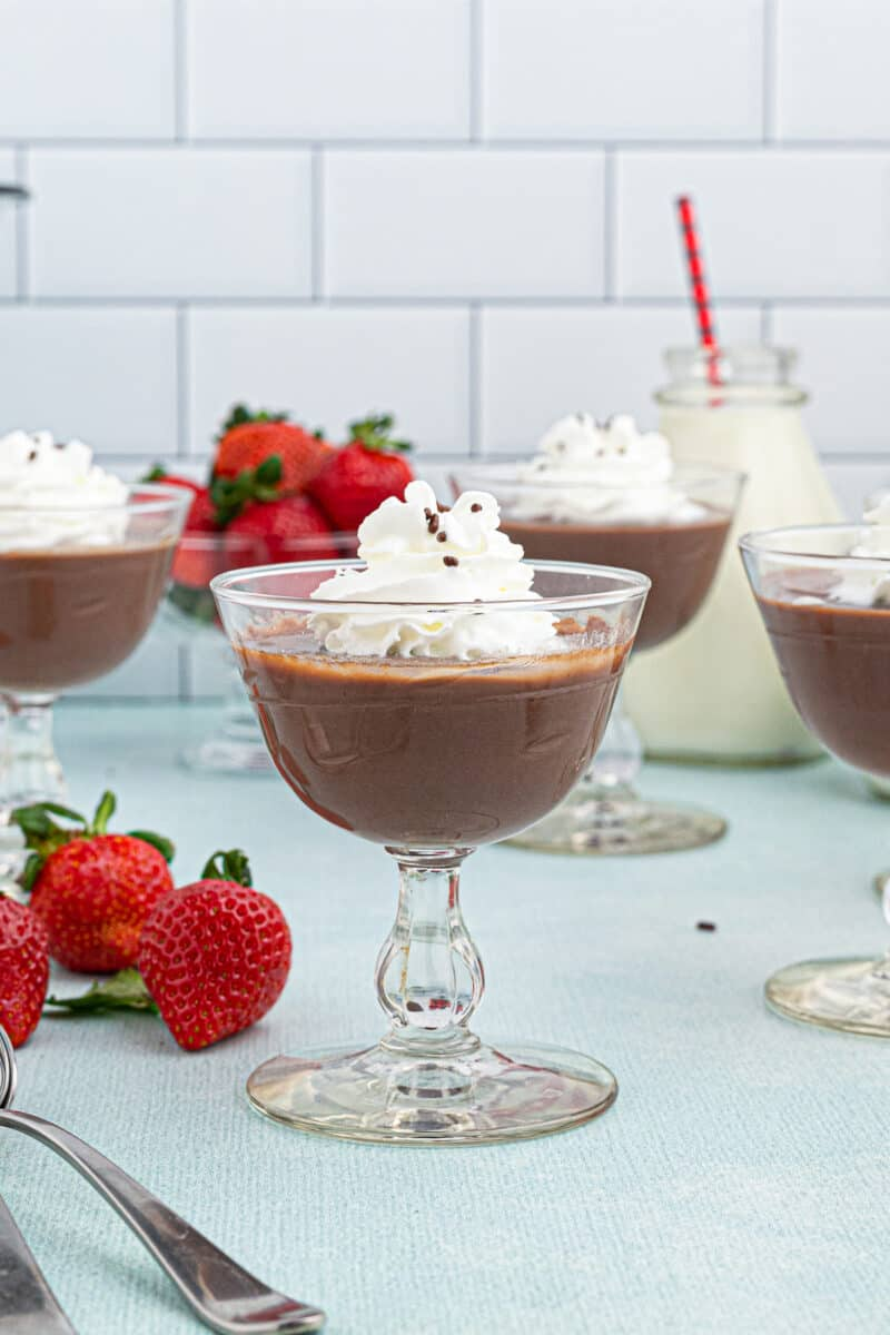 chocolate pudding in cups topped with whipped cream