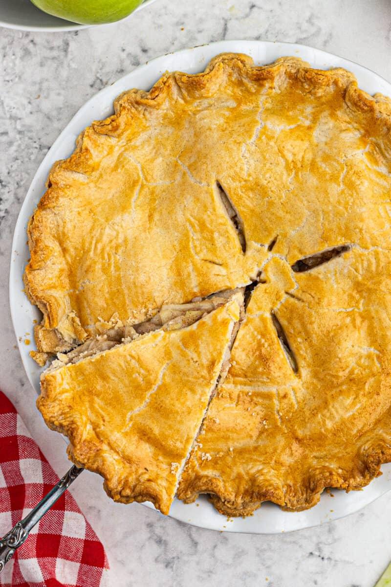 lifting up slice of homemade apple pie