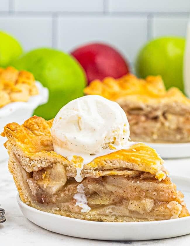 slice of apple pie on plate with ice cream