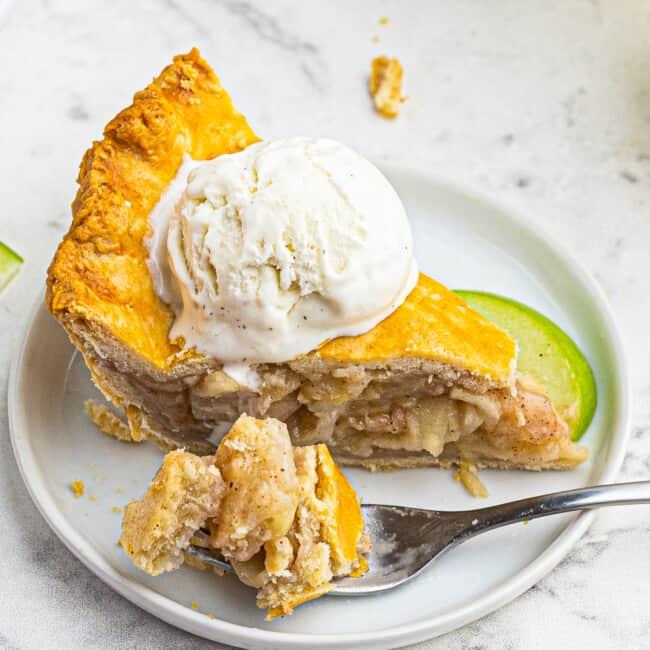 homemade apple pie on plate with ice cream