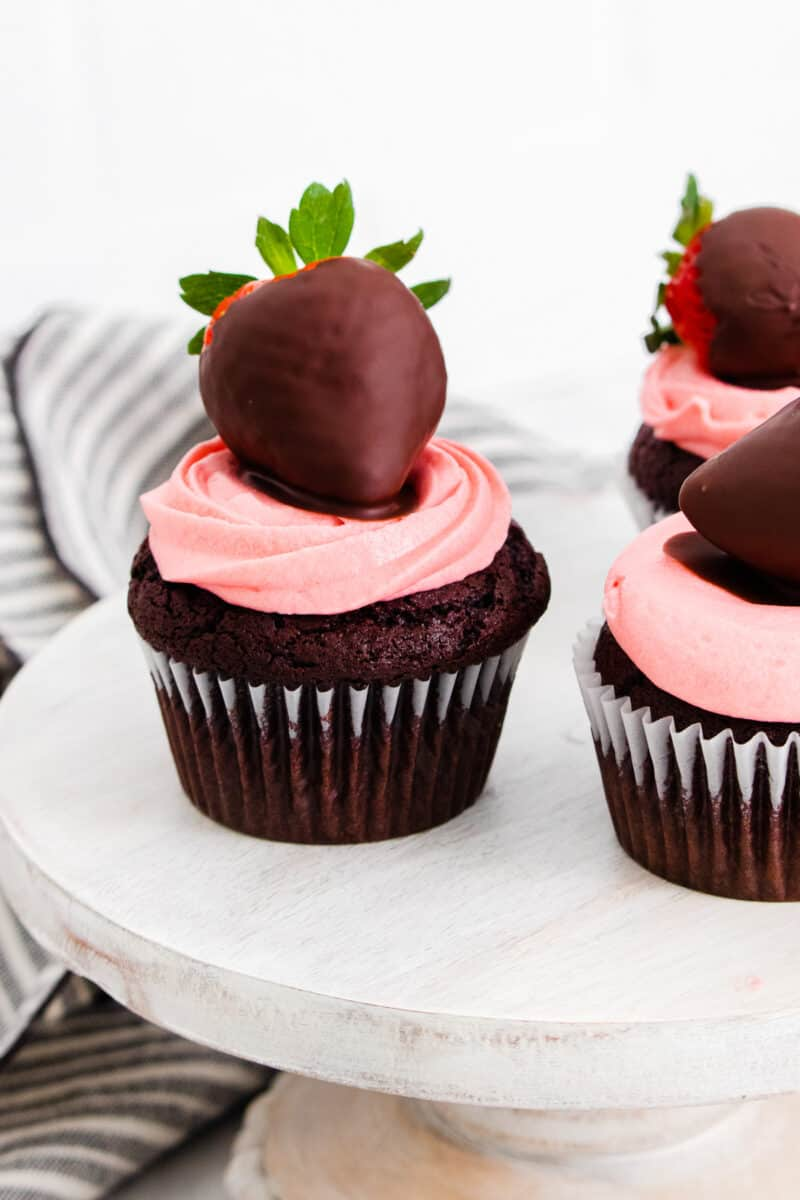 chocolate covered strawberry cupcakes on cake stand