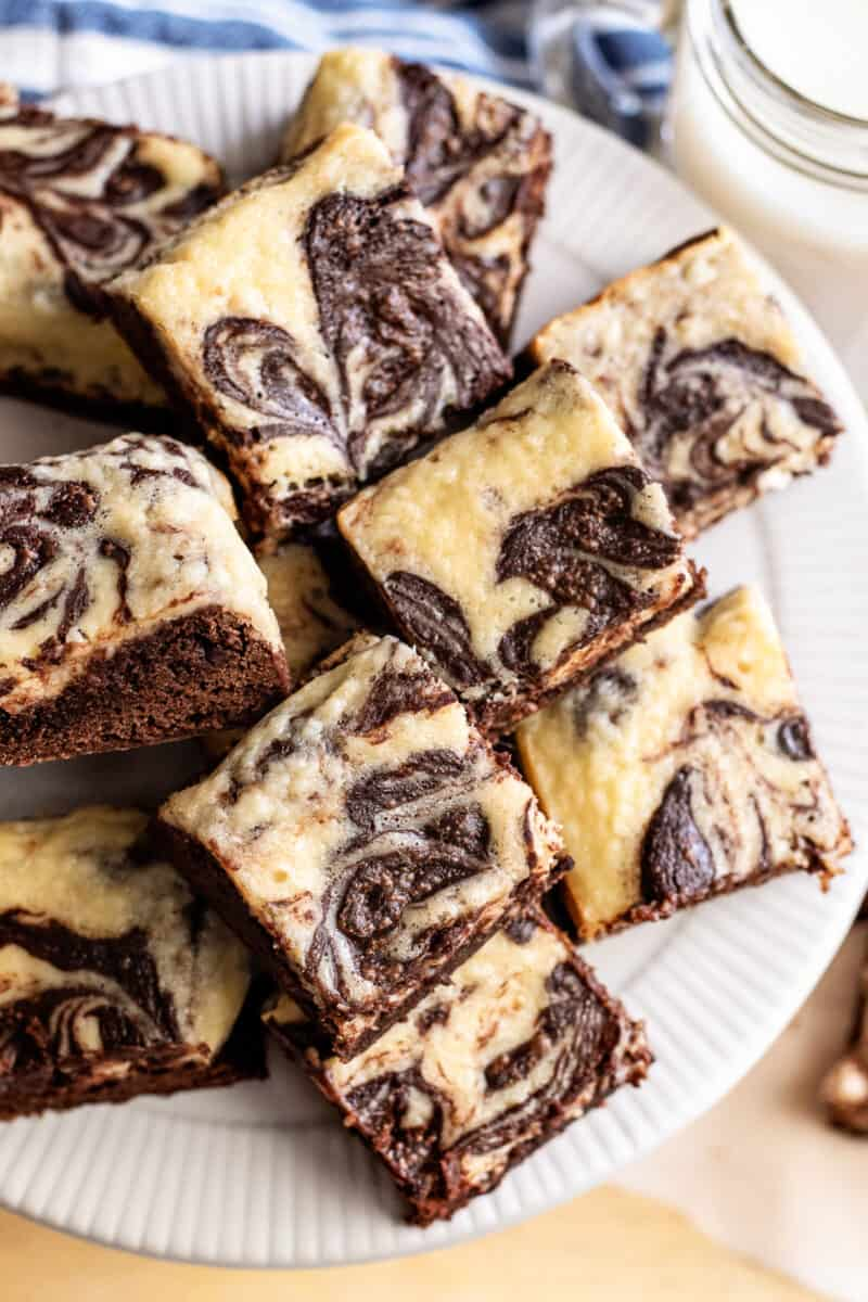 sliced cream cheese brownies stacked on plate