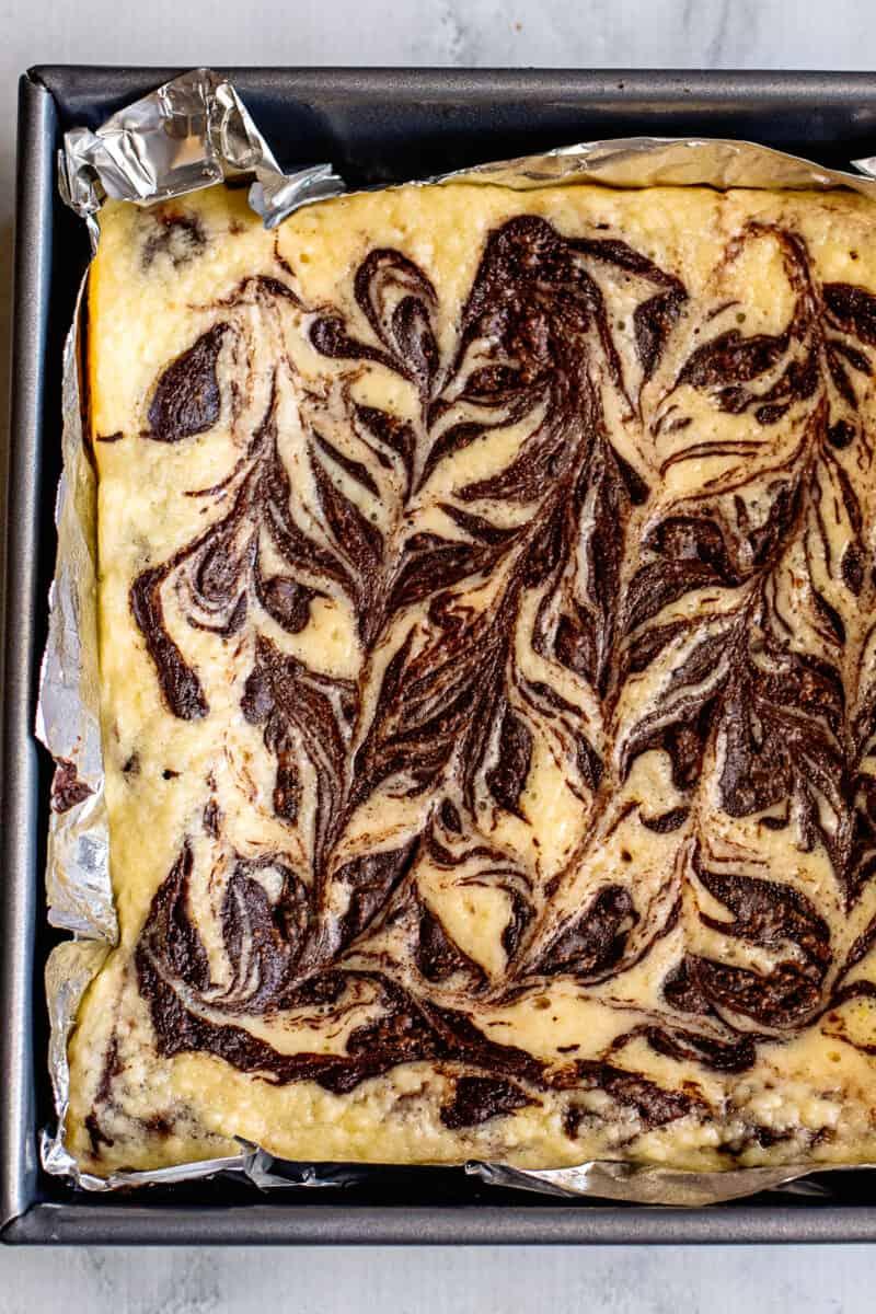 swirled cheesecake brownies in pan