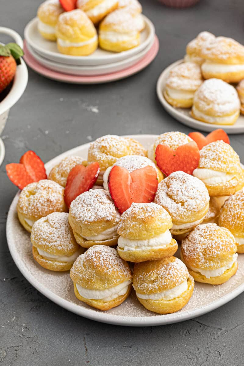 platter of cream puffs with strawberry hearts