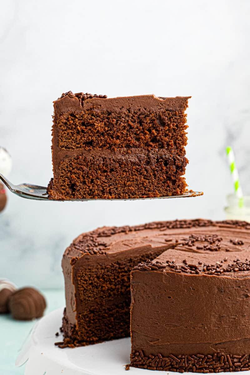lifting up slice of devil's food cake