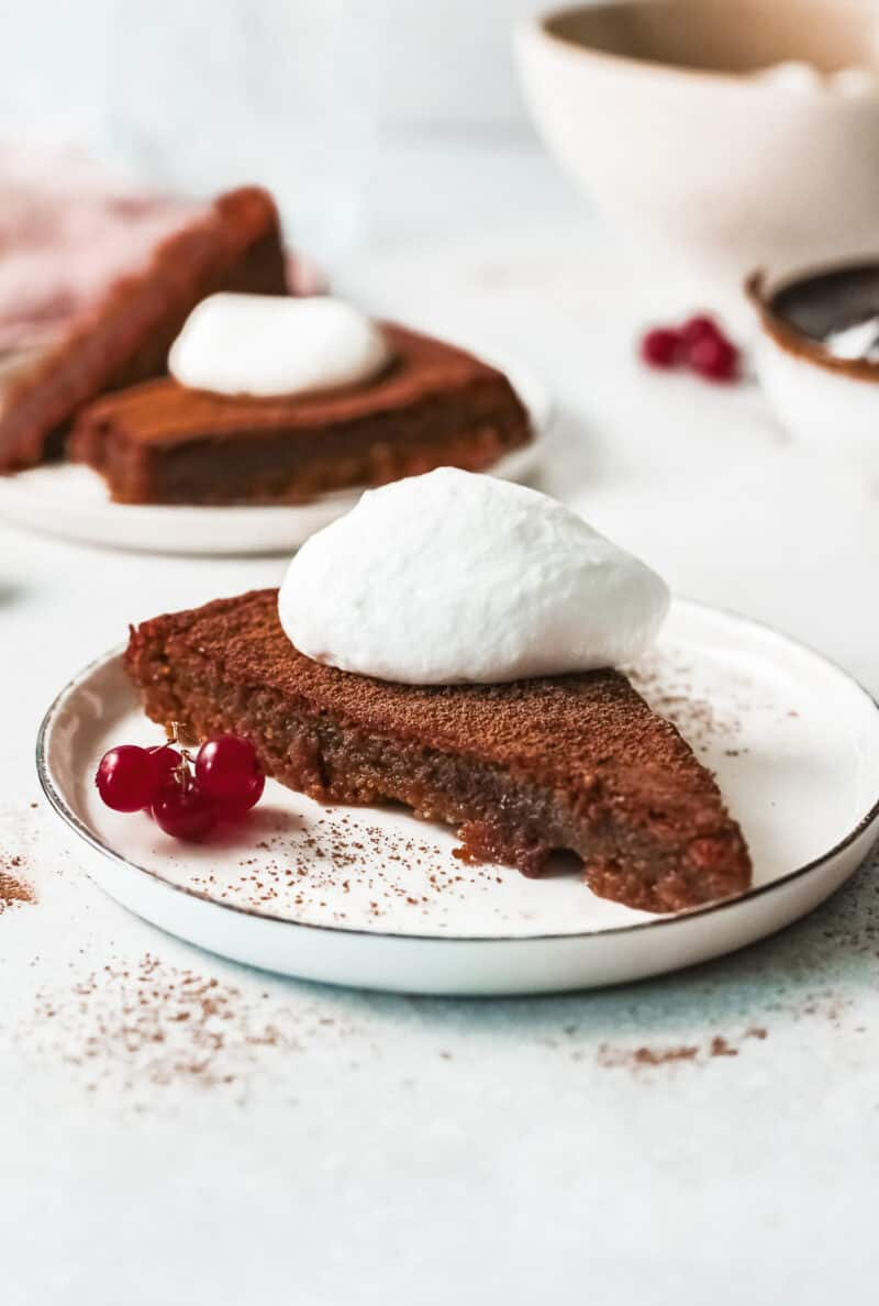 slice of flourless chocolate cake with whipped cream