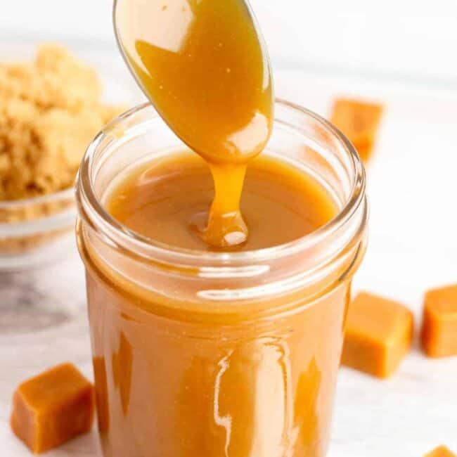 spoon lifting up caramel sauce