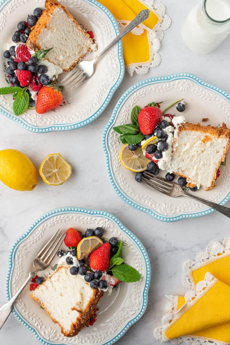 3 slices of lemon angel food cake on white plates