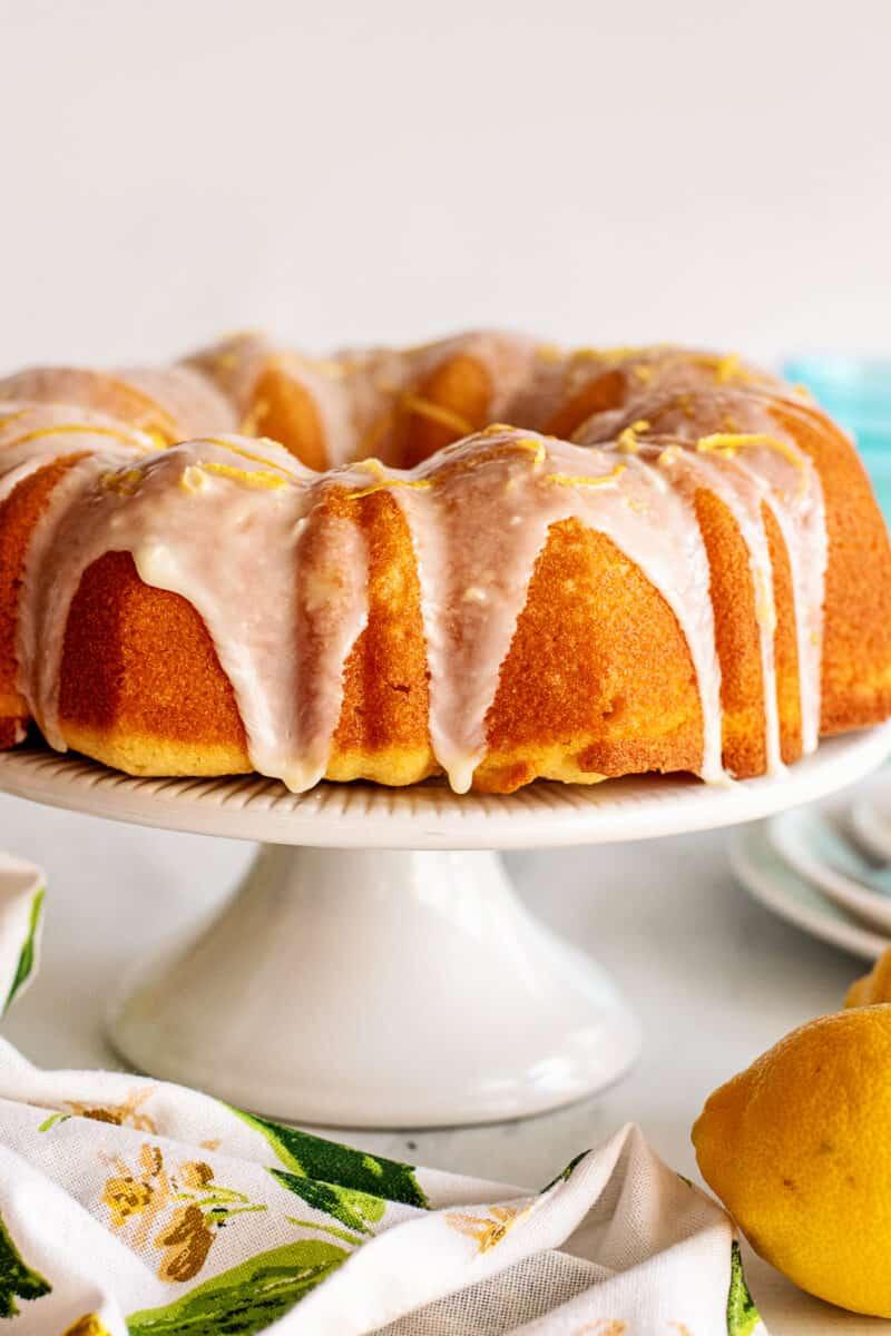 lemon bundt cake on cake stand