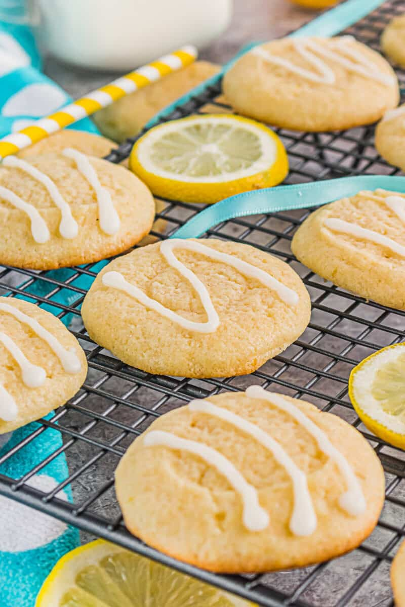 drizzled lemon cookies on cooling rack