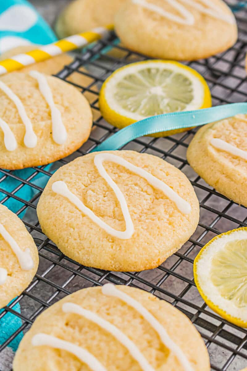 up close drizzled lemon cookies on cooling rack