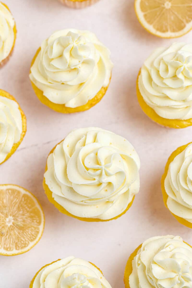 overhead image of lemon cupcakes with lemon frosting