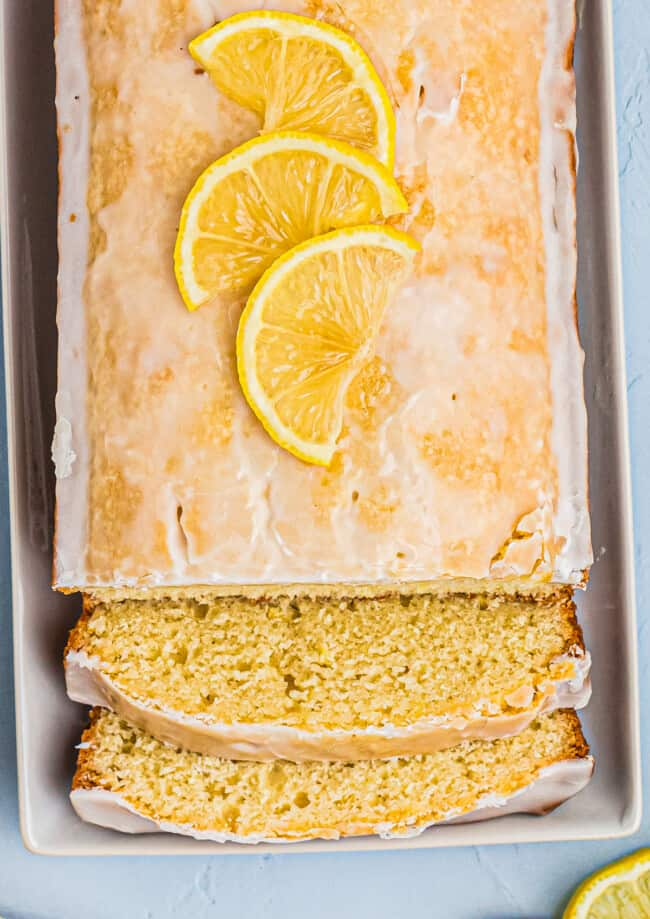 glazed lemon pound cake with two slices
