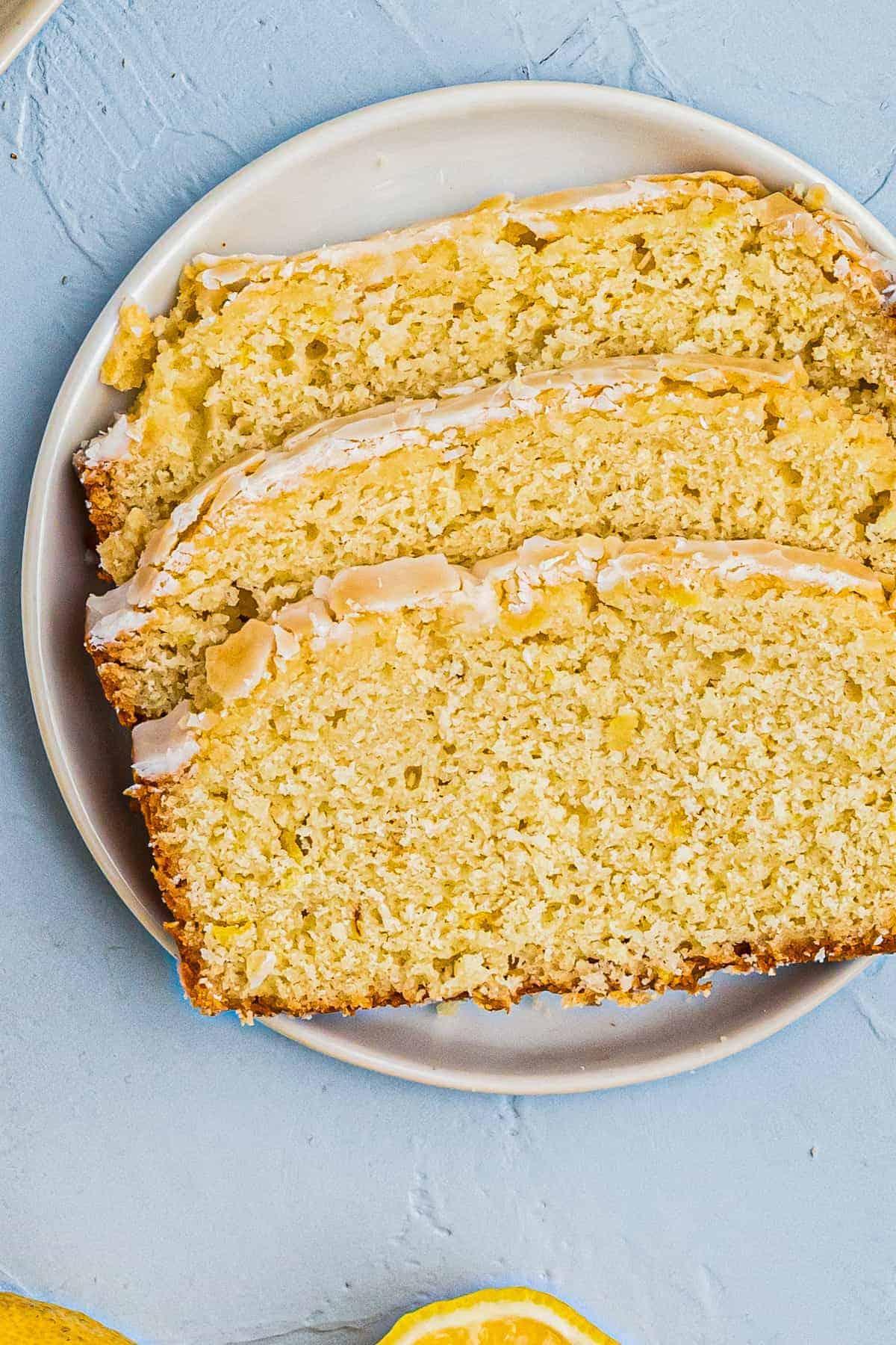 three slices of lemon pound cake on white plate