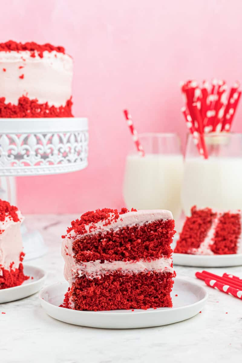 slice of red velvet cake next to vday set up