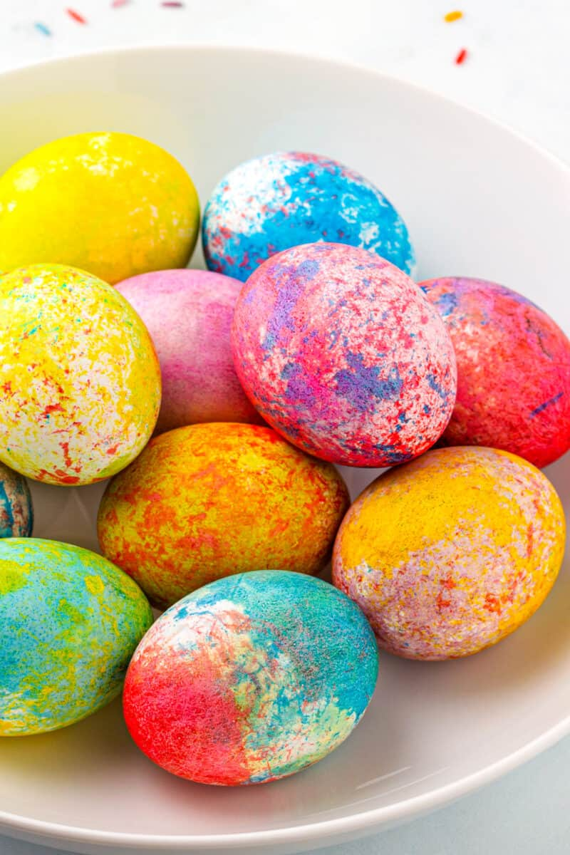 rice dyed easter eggs in many colors in bowl