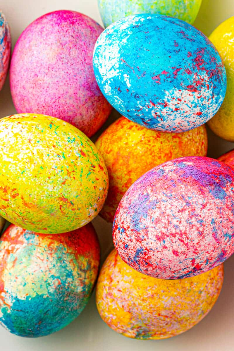 up close rice dyed easter eggs in many colors in bowl