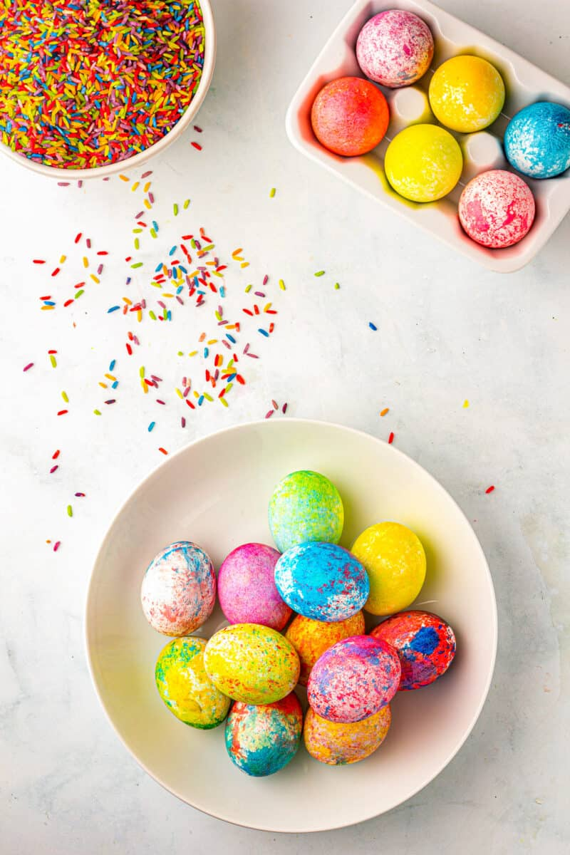bowl of rice dyed easter eggs next to ingredients
