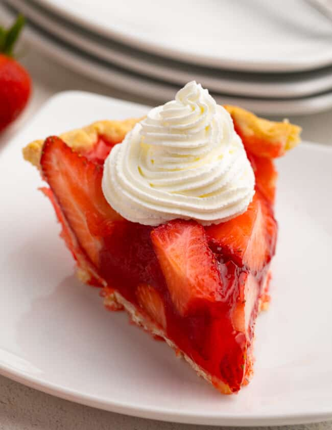 slice of strawberry jello pie with whipped cream