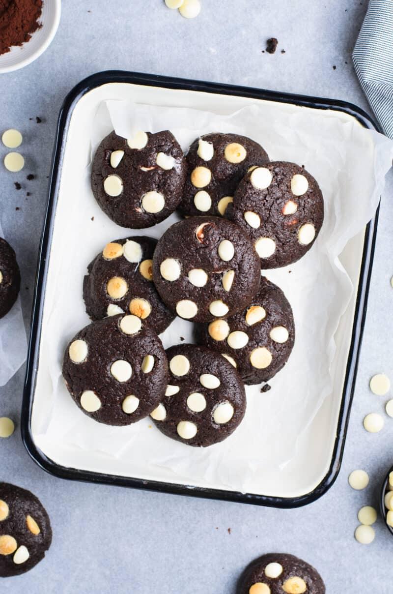 white chocolate chip chocolate cookies on white platter
