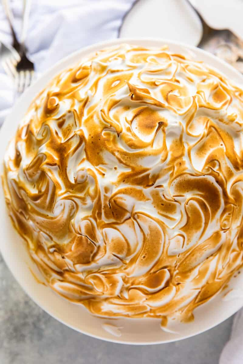 baked alaska with toasted meringue on cake stand