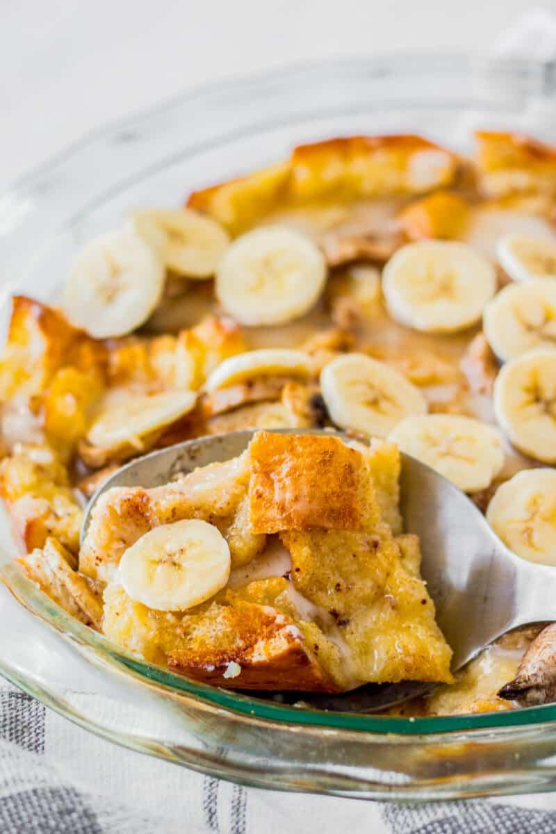 lifting up spoonful of banana bread pudding