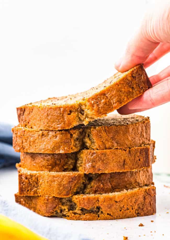 lifting up slice of banana bread