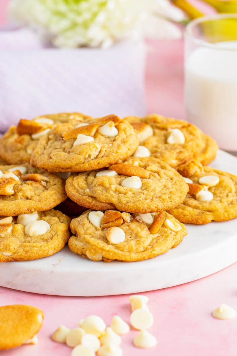 stacked banana pudding cookies on white plate