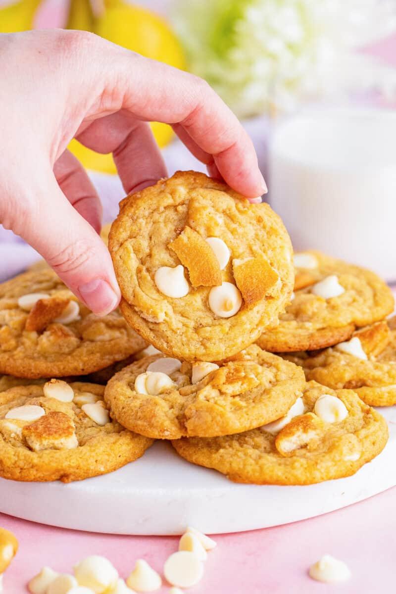 hand lifting up banana pudding cookie