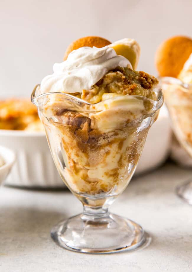 up close banana pudding in parfait dish with whipped cream