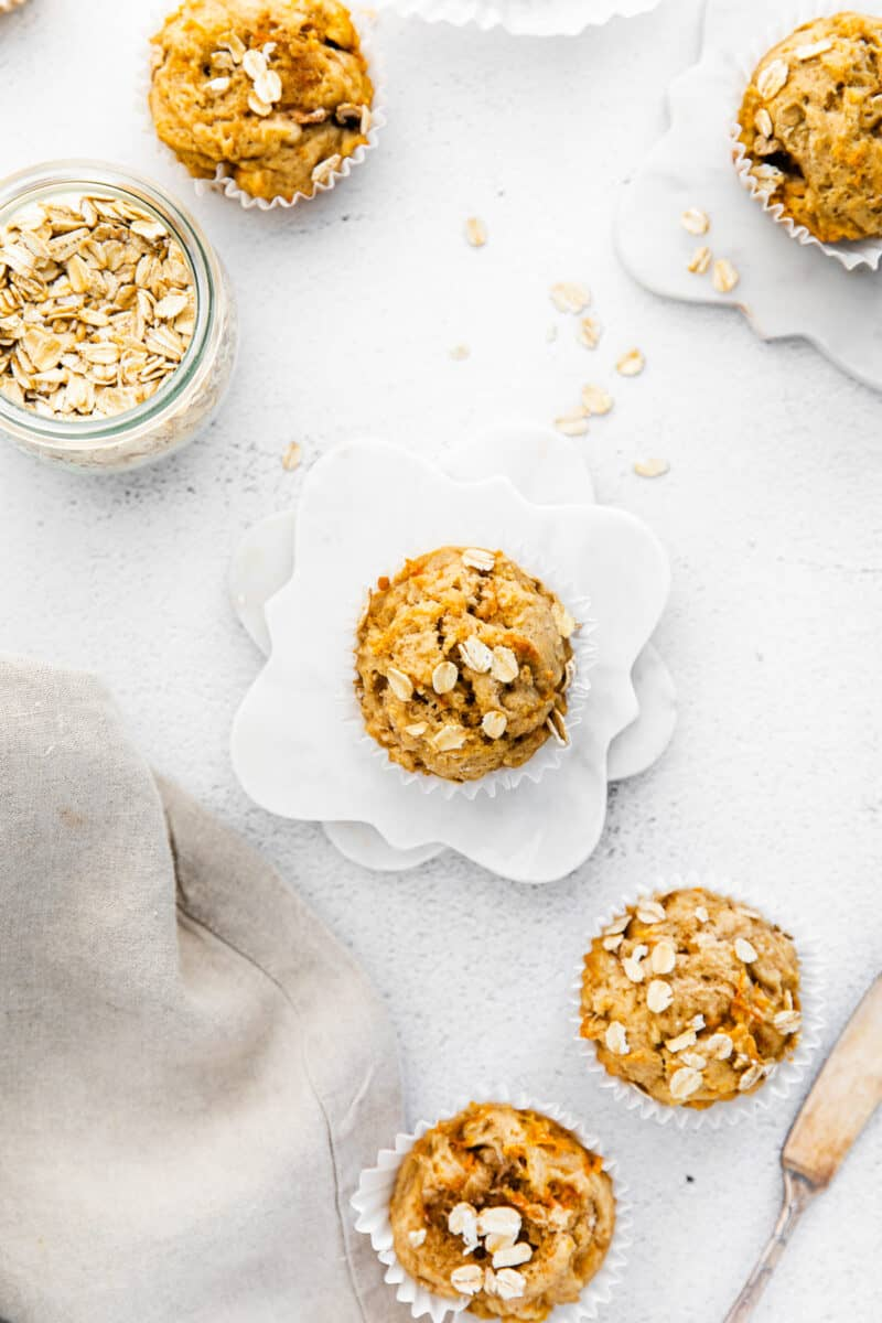 carrot banana muffins overhead image on white table