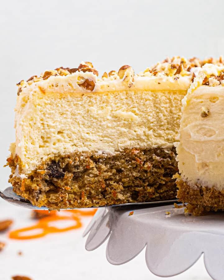 up close slice of layered carrot cake cheesecake