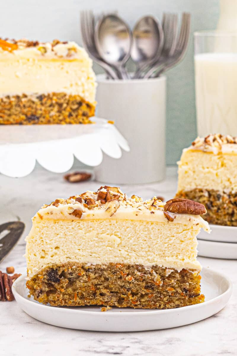 slice of carrot cake cheesecake on plates