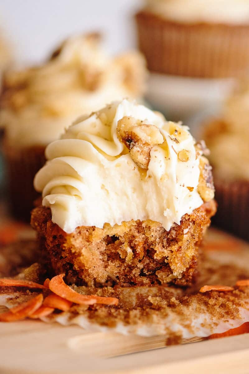 bite out of carrot cake cupcake