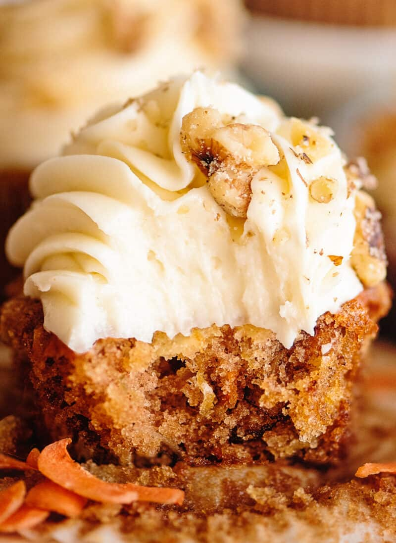 up close bite out of carrot cake cupcake