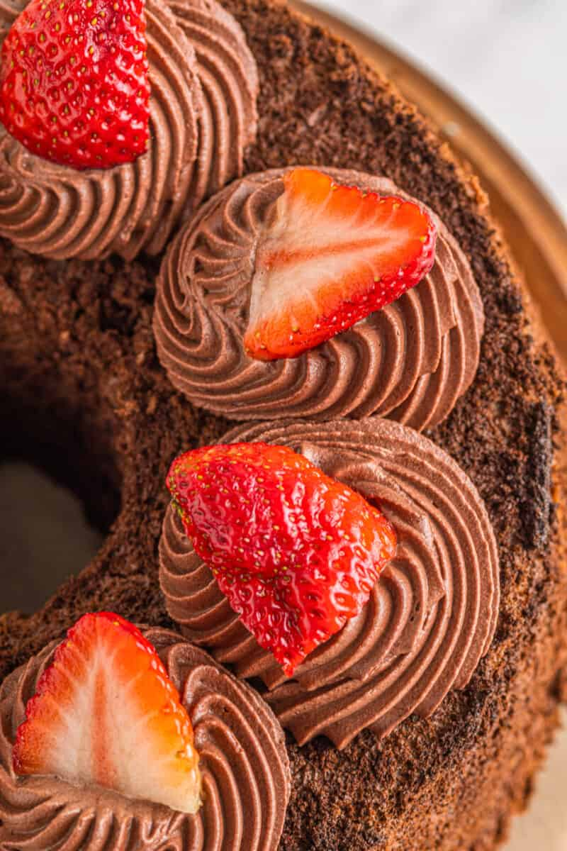 up close overhead image of frosted chocolate angel food cake