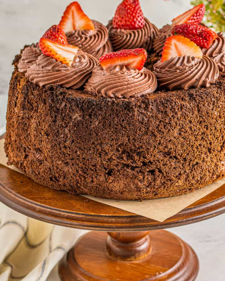chocolate angel food cake on cake stand