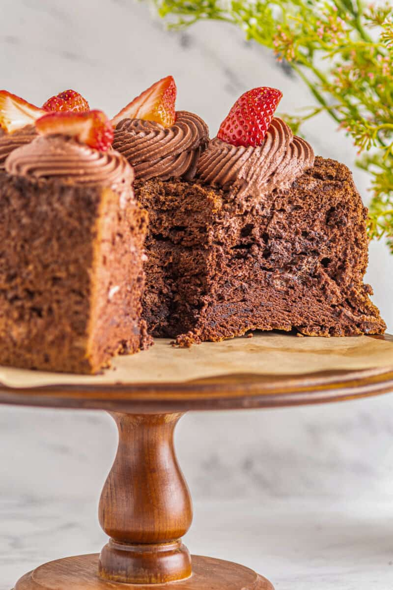 slices out of chocolate angel food cake on cake stand