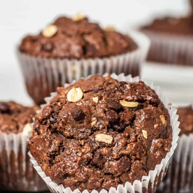 white table with chocolate oatmeal muffins