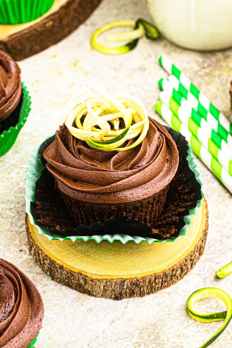 chocolate zucchini cupcake garnished with shaved zucchini