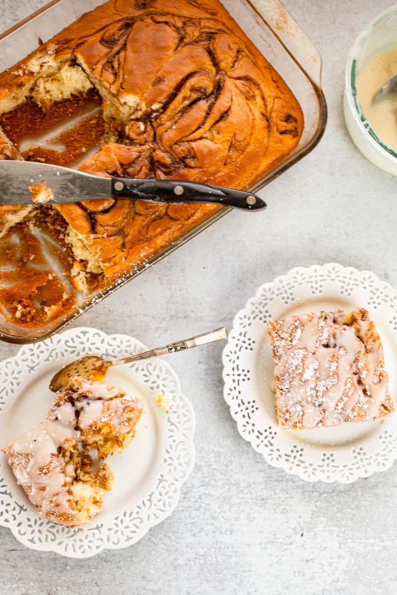 cinnamon roll cake with two slices on plates