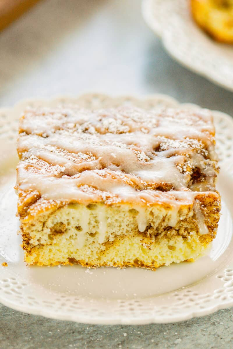 up close cinnamon roll cake with icing