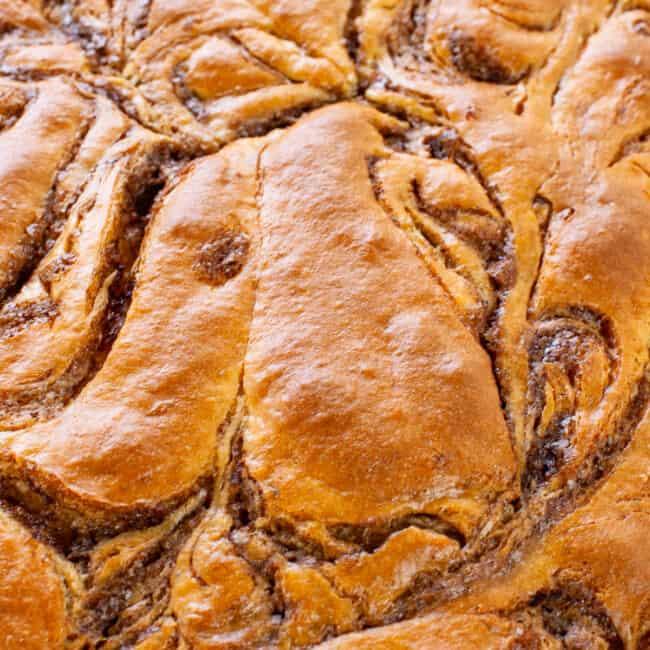 up close image of swirled top of cinnamon roll cake