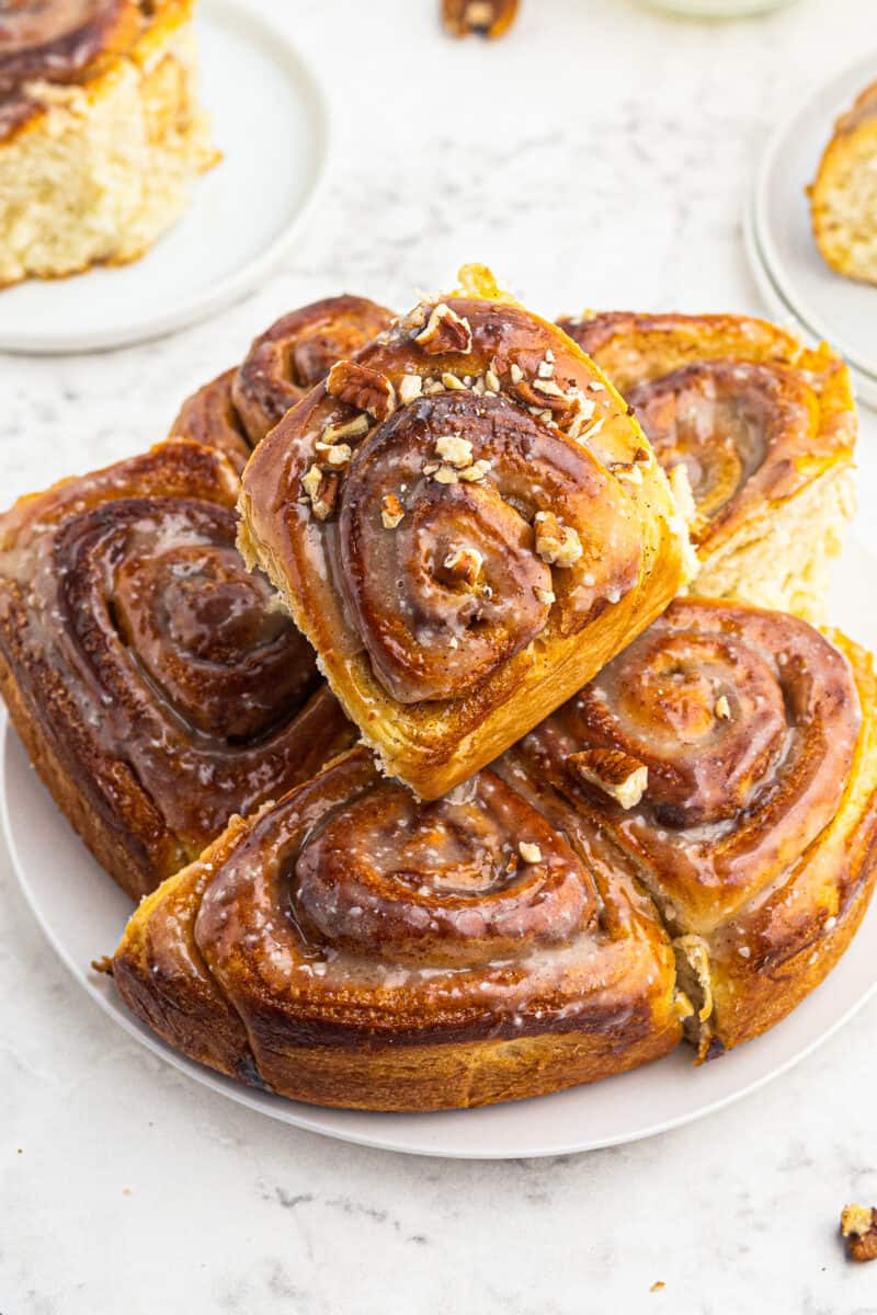 plate with stacked cinnamon rolls
