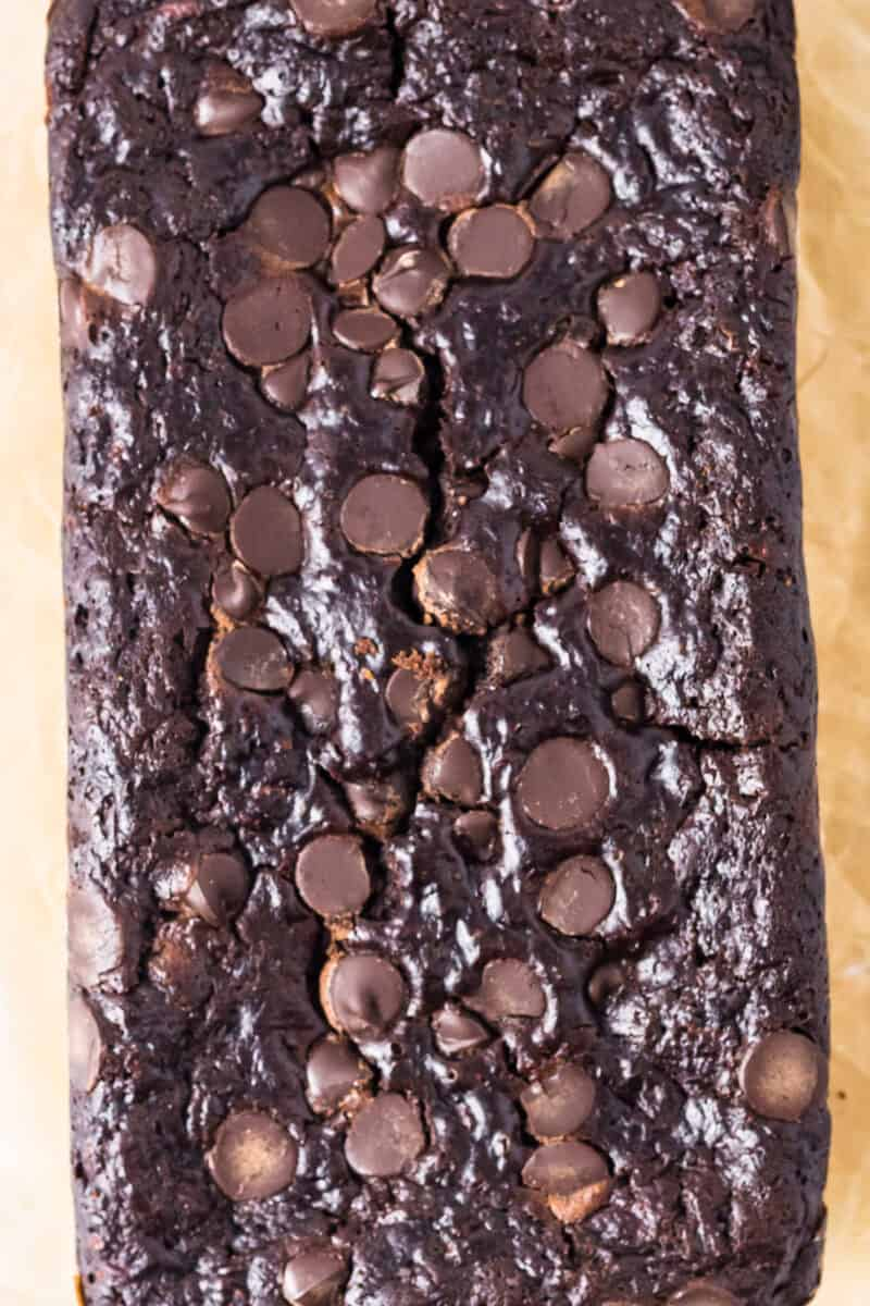overhead unsliced loaf of chocolate zucchini bread